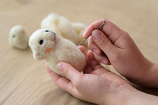 Process of felting a toy from a wool on