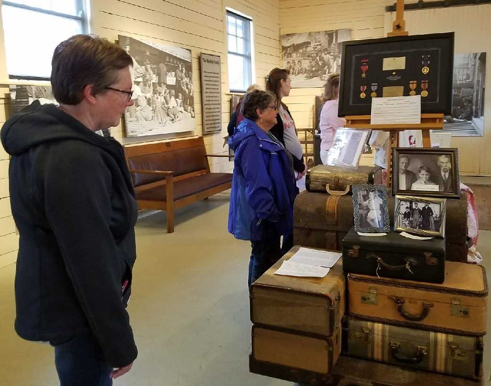 Guests listened to Shaley George, Curator of the National Orphan Train Complex, talk about their current exhibit.