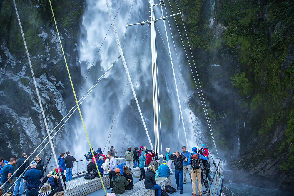 Waterfall in Milford Sound, group tour to New Zealand
