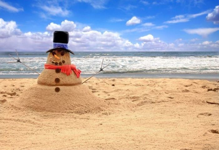 Snowman on a beach, festivals in New Zealand