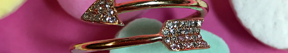 Rose Gold Arrow Ring Featuring Pave Diamonds