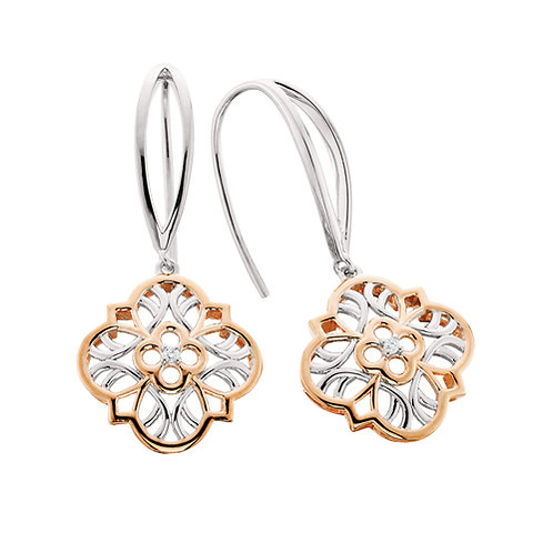 Vintage style drop earrings in sterling silver plated in rose gold with diamond center. Negative space earrings. Vintage.