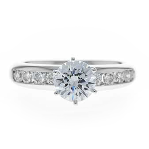 14K white gold diamond engagement ring with channel set diamond accents and white gold sides. White gold diamond engagement.