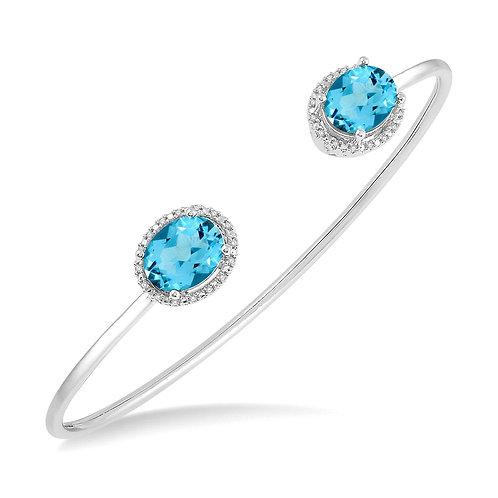 Sterling silver bangle bracelet with Swiss blue topaz and diamonds in vintage inspired filigree settings. Bangle bracelet.