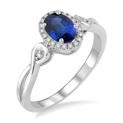 14K white gold diamond ring with oval shaped blue sapphire center stone. Sapphire and diamond ring. Oval sapphire with halo