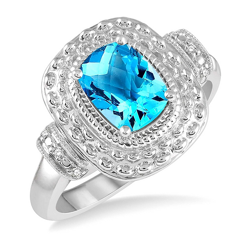 Sterling silver and Swiss blue topaz ring with diamond accents. Diamond accented Swiss blue topaz ring with millgrain details