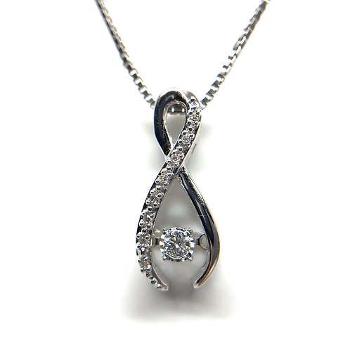 Sterling silver and diamond pendant. Dancing diamond pendant. Dancing diamond sterling silver pendant. Ribbon pendant.