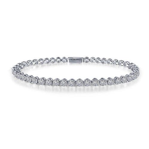 Platinum bonded sterling silver tennis bracelet with bezel set simulated diamond crystal stones. Simulated diamond tennis.
