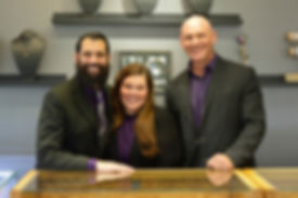 Thurber Jewelers team photo. Evan Silbert, General Manager, Jessica Silbert, Stlyle Consultant, and Erik Thurber, CEO, in our Elk River showroom.