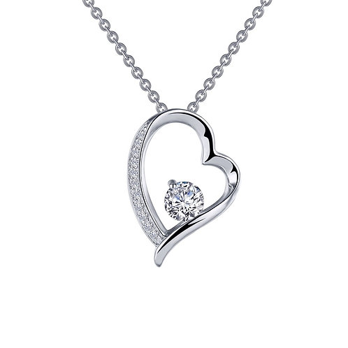 Sterling silver nested heart pendant with simulated diamond center and simulated diamond accented heart. Heart necklace.