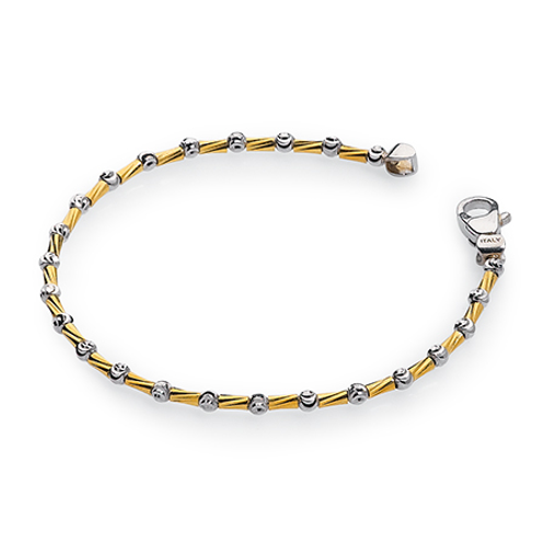 Faceted sterling silver and yellow gold bracelet with sparkling platinum. Made in Italy. Italian bracelet. Faceted bracelet.