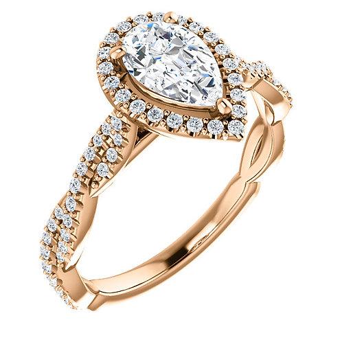 14K rose gold split band style engagement ring with diamond halo. Diamond halo engagement ring. Pear shaped diamond ring.