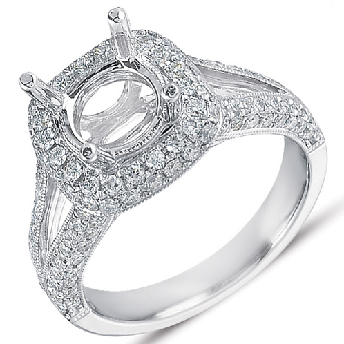 14K White gold vintage inspired engagement ring with diamond halo and millgrain accents. Split band with pave diamonds.