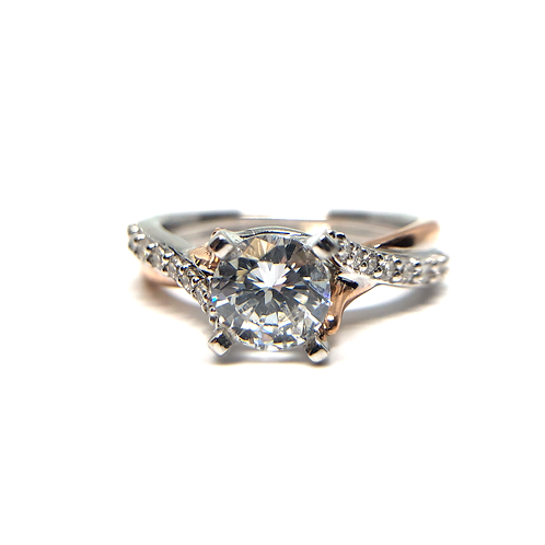 14K white and rose gold twisted style engagement ring with cathedral bypass style shank. Two tone engagement ring. Diamonds.