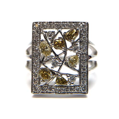 14K white gold and fancy yellow diamond nature inspired ring. White gold and yellow diamond ring. White and yellow diamond.