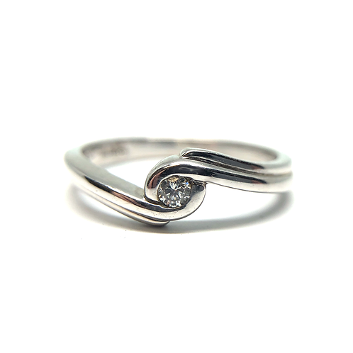 Sterling silver diamond promise ring. Bezel set diamond solitaire promise ring. Bypass promise ring. Silver. Diamonds. Bypass
