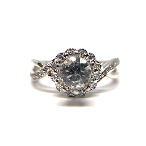 14K white gold diamond halo engagement ring. Diamond accented band with millgrain details. Floral inspired halo. Diamond ring