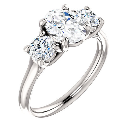 14K white gold three stone diamond engagement ring featuring oval diamond center and round diamond accent stones. Diamonds.