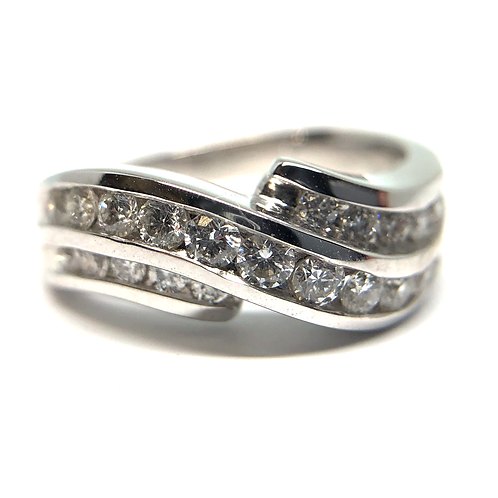 14K white gold ring with channel set diamonds in twisted channel arrangement. White diamonds in white gold channel set. Ring.