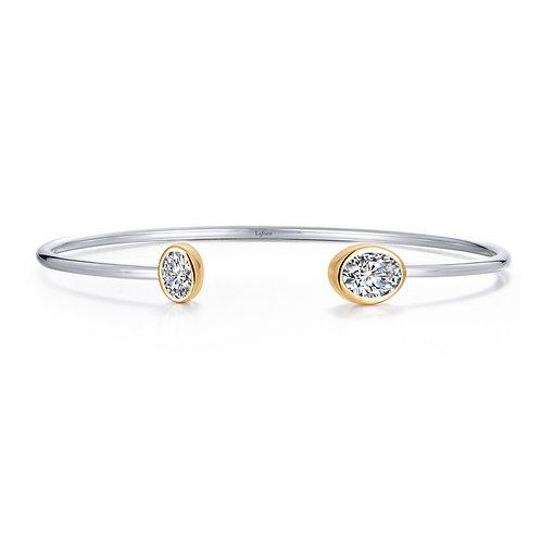 Sterling silver bangle bracelet with oval simulated diamonds. Flexible bangle. Yellow gold plated bezel set simulated diamond
