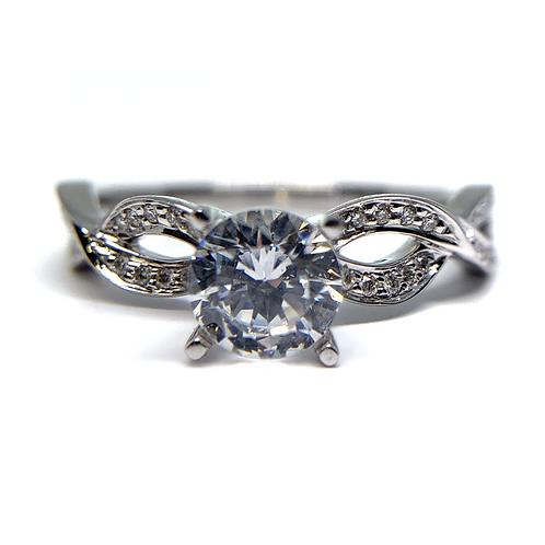 14K white gold diamond engagement ring. White gold ring. White gold diamond. Diamond engagement ring. Twisted diamond ring.