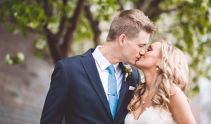 Kissing couple. Wedding photograher. Wedding photography. Blonde woman and man in blue tie. Wedding day photo. Wedding photos. Wedding photographer in Elk River, Minnesota.