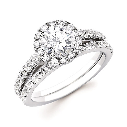 White gold engagement ring with round diamond center and diamond halo. Diamond accented band and diamond wedding band.