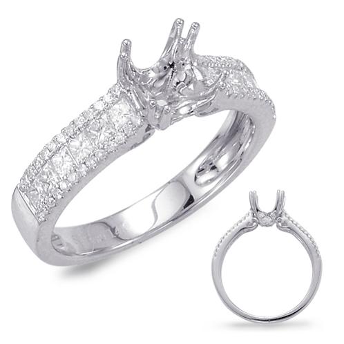 14K White gold and princess cut diamond engagement ring with channel set princess cut diamonds and prong set round diamonds.