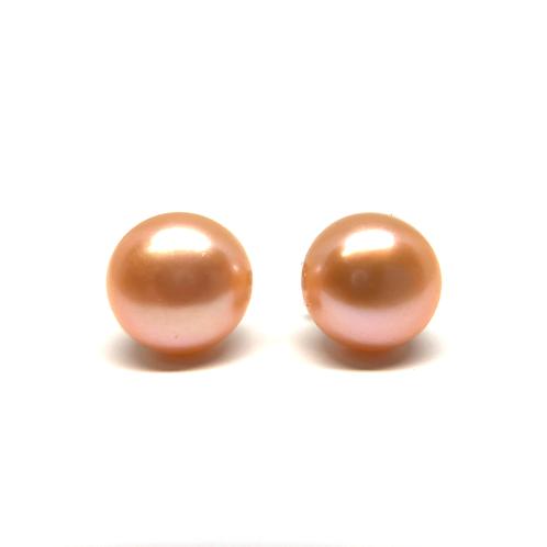 Pink pearl stud earrings. Peachy pink pearl stud earrings. Peach pearl studs. Pink pearl stud earrings. Pink pearl studs.