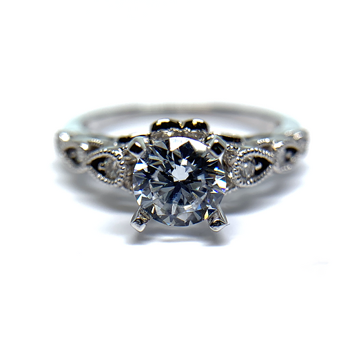 14K white gold diamond engagement ring with vintage inspired millgrain details and diamond accents. Pod style ring. Cage open