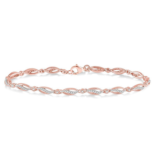 10K rose gold wave bracelet with diamonds. Diamond bracelet. Rose gold diamond bracelet. Rose gold wave bracelet. Diamonds.
