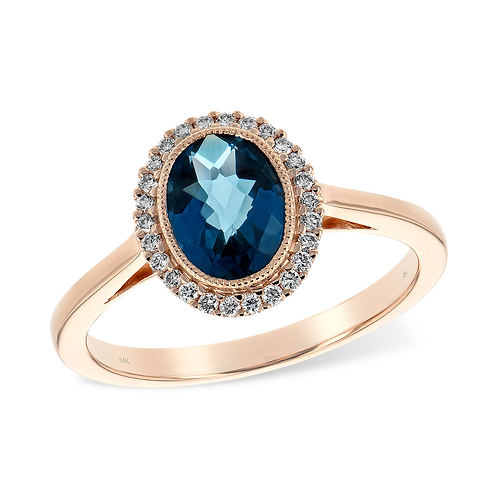 Rose gold ring with oval London blue topaz and diamond halo. Vintage inspired style. Millgrain details.