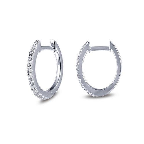 Platinum plated sterling silver huggie hoop earrings with simulated diamonds. Huggies. Sterling silver huggie earrings. Huggy
