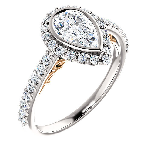 14K white gold diamond engagement ring with rose gold accented cathedral and bezel set pear shaped center stone and diamonds.