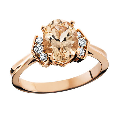 10K rose gold ring with .14cttw diamonds and oval shaped morganite center stone. Rose gold morganite ring with diamonds. Rose