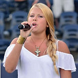 Model and Promotional Partner Abigail singing at the West Virginia Black Bears Game