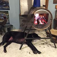 Artist, Flintknapper and Carver, Ben Kolb's dog in the studio