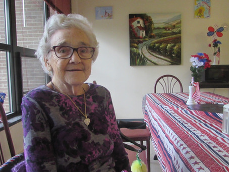 Purple and Laconia Housing make her smile