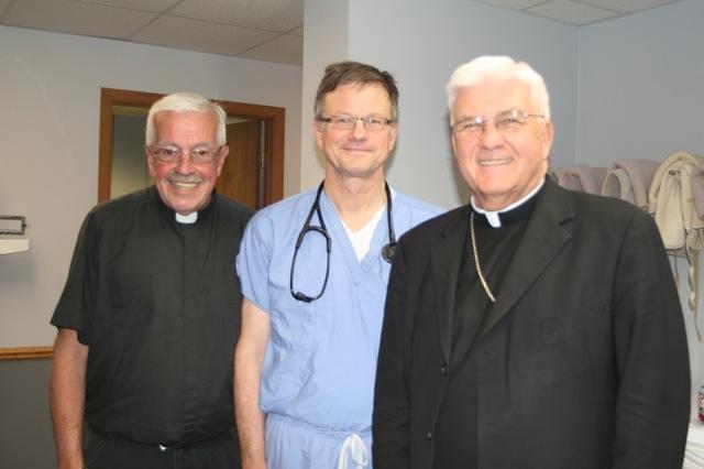 Fr. Jim, Dave and Bishop Quinn