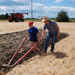 Jeff and Daughter Sophie Plowing