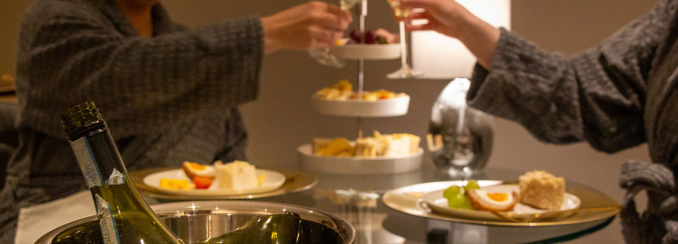 Women_clinking_champagne_flutes_over_custom_lunch_at_spa.jpg