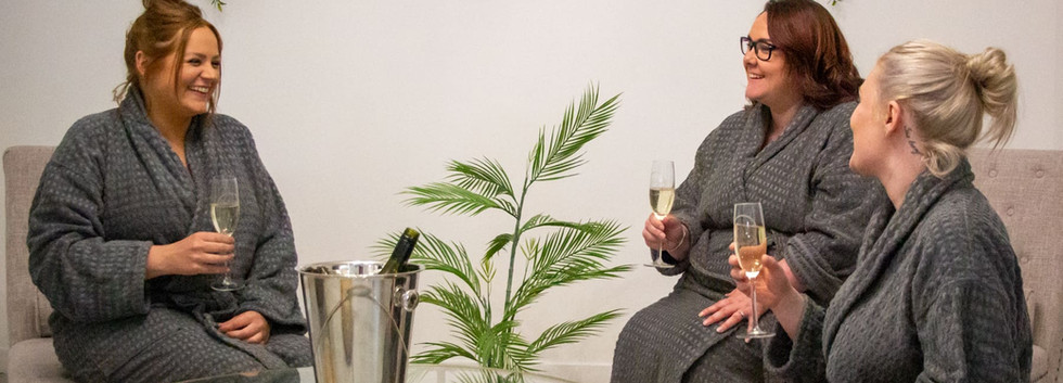 women_enjoying_champagne_together_at_luxury_spa.jpg