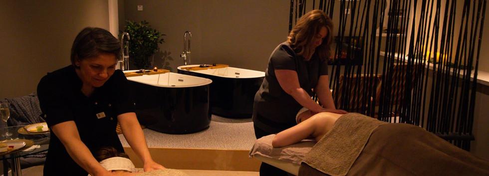 women_enjoying_swedish_massages_in_private_room_at_luxury_spa.jpg