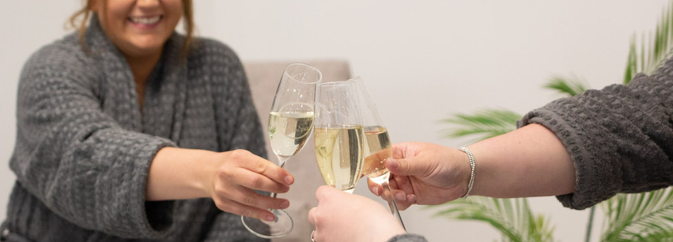 Women_clinking_custom_champagne_glasses_in_private_party.jpg