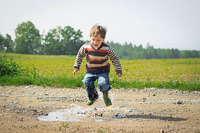 boy-jumping-near-grass-at-daytime-110401
