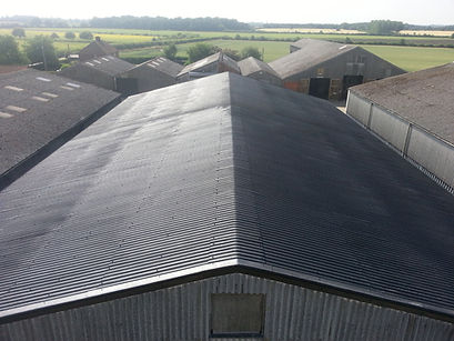 Rubber spray repaired commercial roof