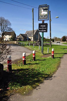 Standing guard posts and The White Hart pub sign
