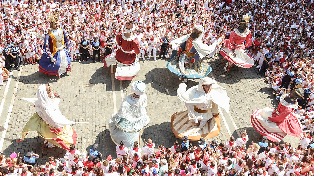 Cabezudos dancing in the parade during Pamplona Running of the Bulls