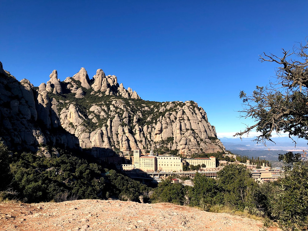 View of the Monserrat buildings from the trails in Spain