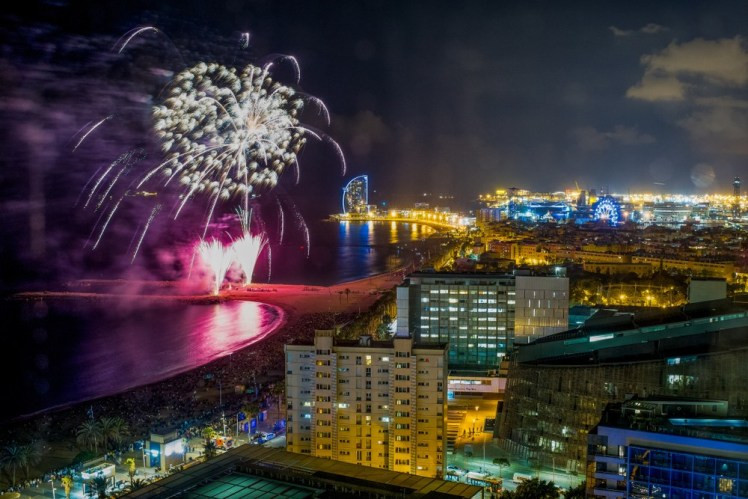 Fireworks display from an apartment rooftop in Barcelona during Fire Festival